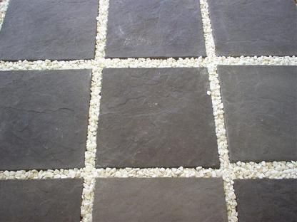 Jenkor Charcoal Slabs with Decorative Stone Borders