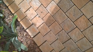 Paving bricks and slabs